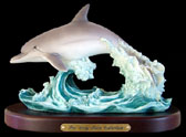 Single Dolphin Figurine on Wooden Base