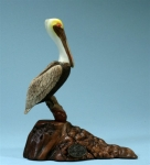 Pelican Sculpture on Burl Wood